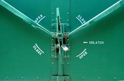 Green Rail Car Lock. Green railroad car lock on door panel Royalty Free Stock Photography