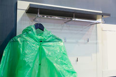 Green raincoat. Hangs on the rack Royalty Free Stock Images