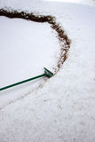 Green rake in a snow covered bunker Stock Photo