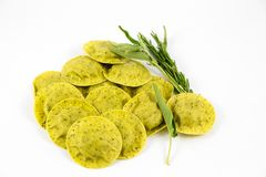 Green ravioli with sage and rosemary. In a white background Stock Image