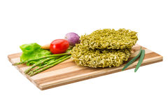 Green raw noodles. With asparagus and vegetables Stock Images