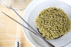 Green raw noodles in bowl Royalty Free Stock Photo