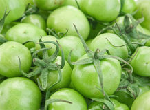 Green raw tomato Stock Photos