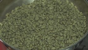 Green raw unroasted coffee beans in roaster close up. Green raw unroasted coffee beans in roaster stock video