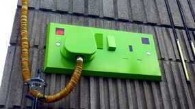 Green Rectangular Corded Machine on Grey Wall during Daytime Stock Image