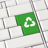 Green recycle icon on a computer keyboard Royalty Free Stock Photography