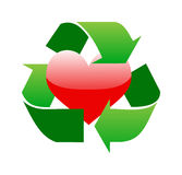 Green recycle sign around red glossy heart Royalty Free Stock Photo
