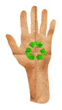 Green recycle sign on hand Royalty Free Stock Photos
