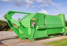 Green recycle skip with electric compressor Stock Photo