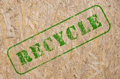 Recycle stamp on a recycled wooden background Stock Photos