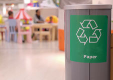 The green recycle symbol on the bin. Royalty Free Stock Photo