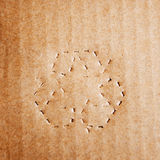 Green recycle symbol on cardboard Stock Images