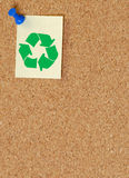 Green recycle symbol on corkboard. Corkboard with recycle symbol on thumb tacked note Stock Photo