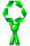 Green recycle symbol and man. Cartoon of a green man holding a big recycle sign over his head Royalty Free Stock Photos