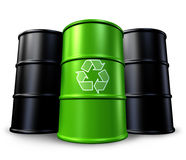 Green recycling barrel with oil drums Royalty Free Stock Images