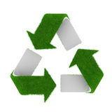 Green recycling symbol covered with grass Royalty Free Stock Image