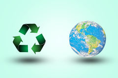 Green recycling symbol world contender on a pastel background. color.Environment .concept.Ecology concept.The harmonious.Elements Stock Photography