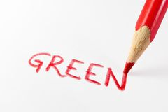 Green in red Stock Images