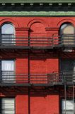 Green and Red. Brick facade in green and red, New York Stock Photo