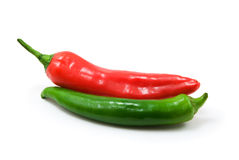Green and red. Peppers isolated on white background royalty free stock images