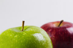 Green and Red Apple. Close up shoot of green and blurry red apple on background isolated on white Stock Photography