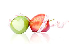 Green and red apple isolated on white background and measuring t Stock Photo