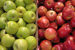 Green and red apples. Two boxes of green and red apples royalty free stock photos