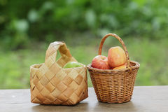 Green and red apples in a basket Stock Photo