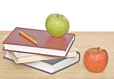Green and red apples and books Stock Photo