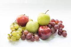 Green and red apples and grapes. In white background Royalty Free Stock Photography