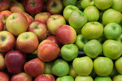Green and red apples on shelf. Green and red apples heap on shelf Stock Photography