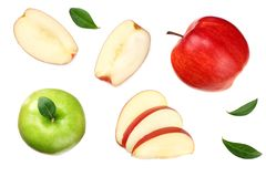 green and red apples with slices isolated on white background. top view stock images