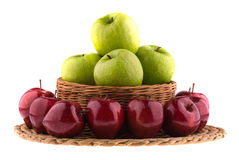 Green and red apples in a wicker baskets. Stock Photography