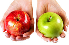 Green apple. Green and red apples in the woman's hands Stock Images