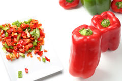 Green and red bell peppers Stock Images