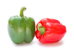 Green and red bell peppers. On a white background Stock Images