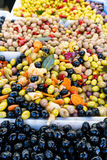 Green, red and black olives, chilies, preserves in a French market in Paris France Royalty Free Stock Photos
