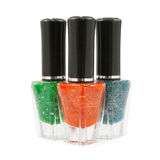 Green red  blue nail polish bottle Stock Photography