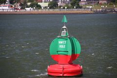 Green red buoy to mark a split in the canal Nieuwe Waterweg in the harbor of Rotterdam royalty free stock image