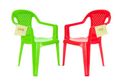 Green and red chair for debate stock image