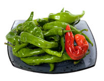 Green and red chili peppers on glass plate Stock Photography