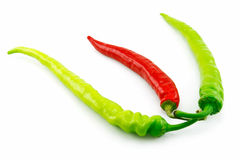 Green and Red Chili Peppers Isolated on White Royalty Free Stock Photo