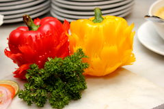 Green and red chili peppers on white cut board Stock Images