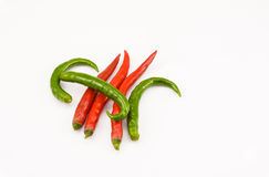 Green and red chili. Some green and red chili on the white background Royalty Free Stock Photography