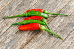 Green and red chilli pepper  on old wood Royalty Free Stock Photo