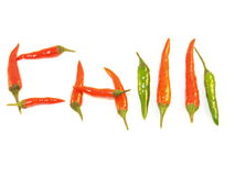 Green and Red Chillies. Chilli written in Green Finger Chillies and Bird Eye Chillies on a white background Royalty Free Stock Photography
