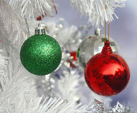 Green and red Christmas ball hang on pine Stock Photography