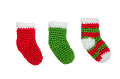 Green and red christmas sock ornaments on isolated white backgro Stock Images