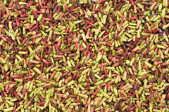 Green and red cloves for sale in market Royalty Free Stock Images