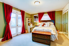 Green and red cozy young adult room Stock Photos